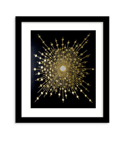 Handmade gold starburst wall decor with black mirrors