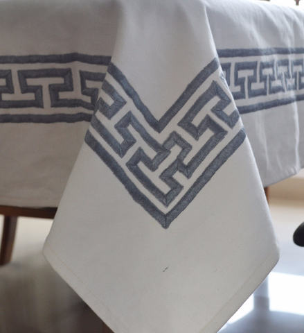 White table cloths and table linens with Greek key embroidery