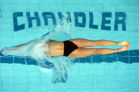 Female Swimmer Diving Into Pool / 100415