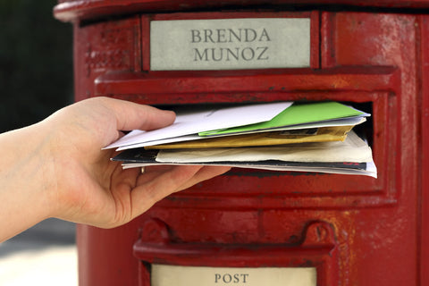 Letters Being Put Into Post Box / 100523