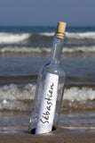 Message In a Bottle Standing On Blurry Sea Shore / 100528