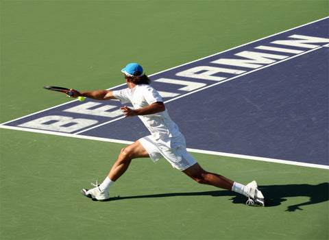 Tennis Player Reaching for the Ball / 100413