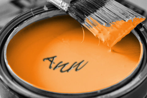 Tin Of Orange Paint and Brush Closeup / 100507