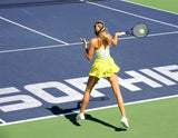 Woman Playing Tennis / 100396