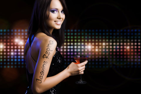Woman With Tatoo At Night Club / 100506