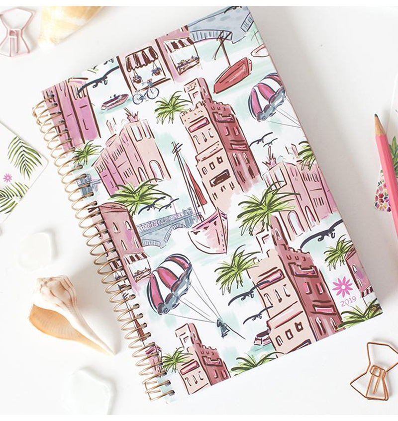 Bloom's Wanderlust 2019 Soft Cover Daily Planner with Binder on a Desk