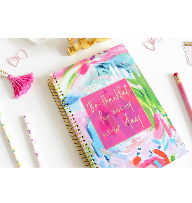 Bloom Be Thankful For Every New Day 2019 Soft Cover Daily Planner on a Desk