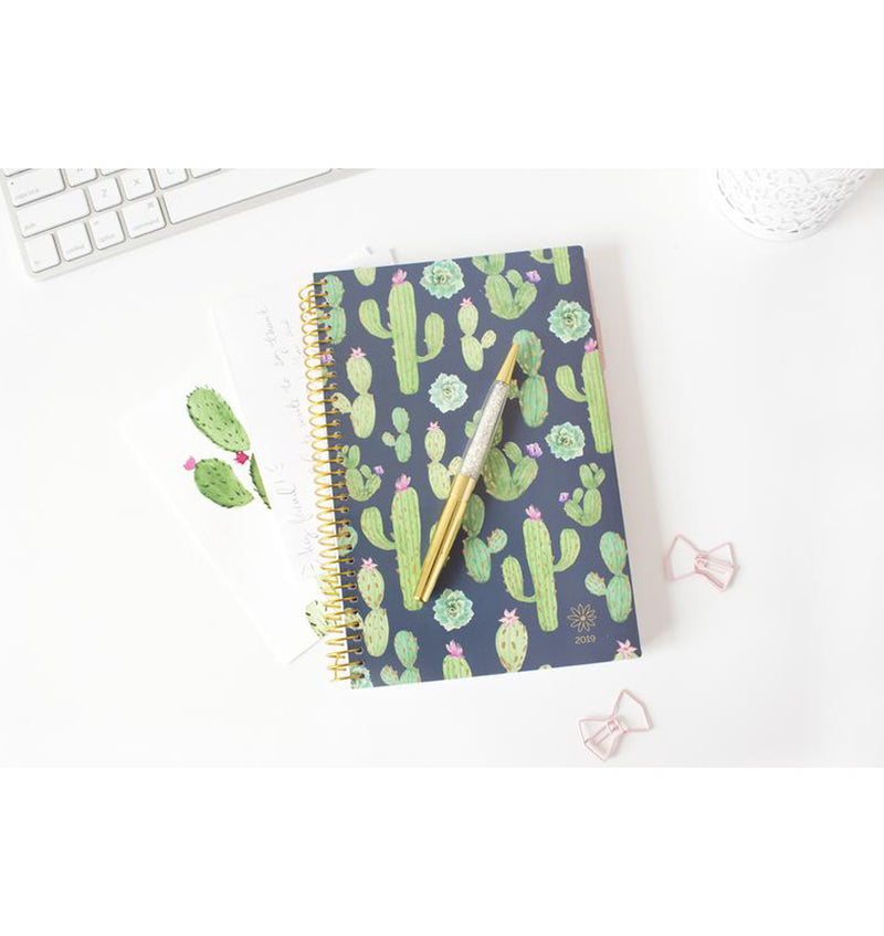 Bloom Navy Cacti 2019 Soft Cover Daily Planner on a Desk