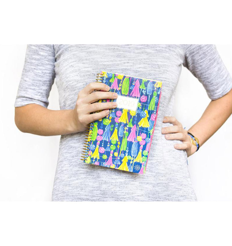 Lady in Light Grey Holding a Bloom Navy Based Tassels 2019 Soft Cover Daily Planner