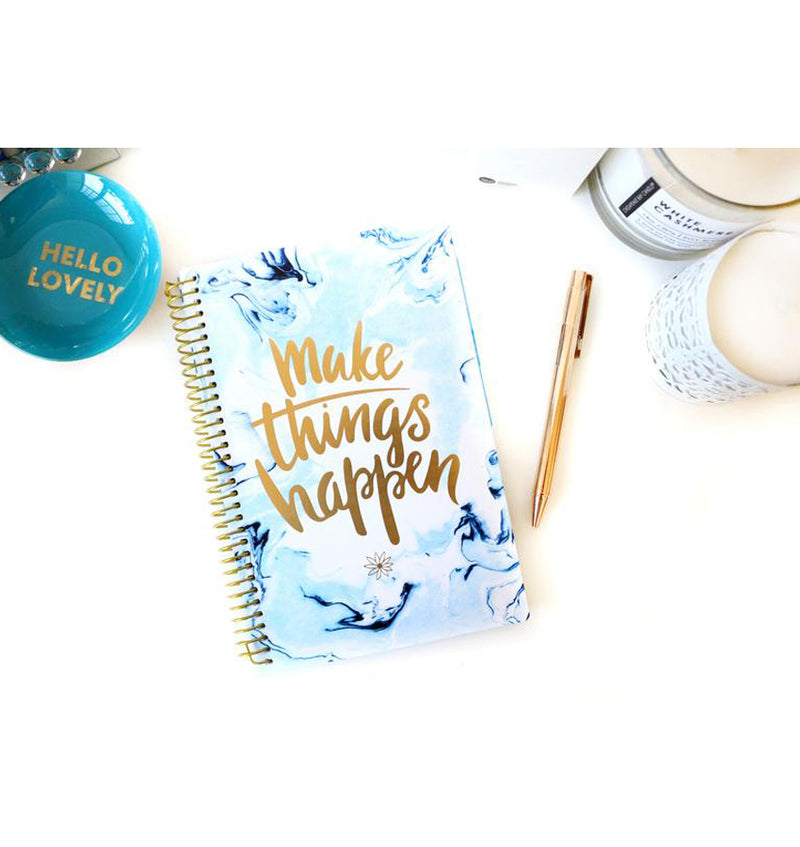 Bloom Make It Happen Daily Softcover Planner Undated on a Desk with a Gold Pen