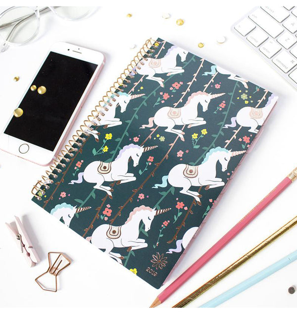 Bloom's Unicorn 2019 Soft Cover Daily Planner on a Desk with Stationery