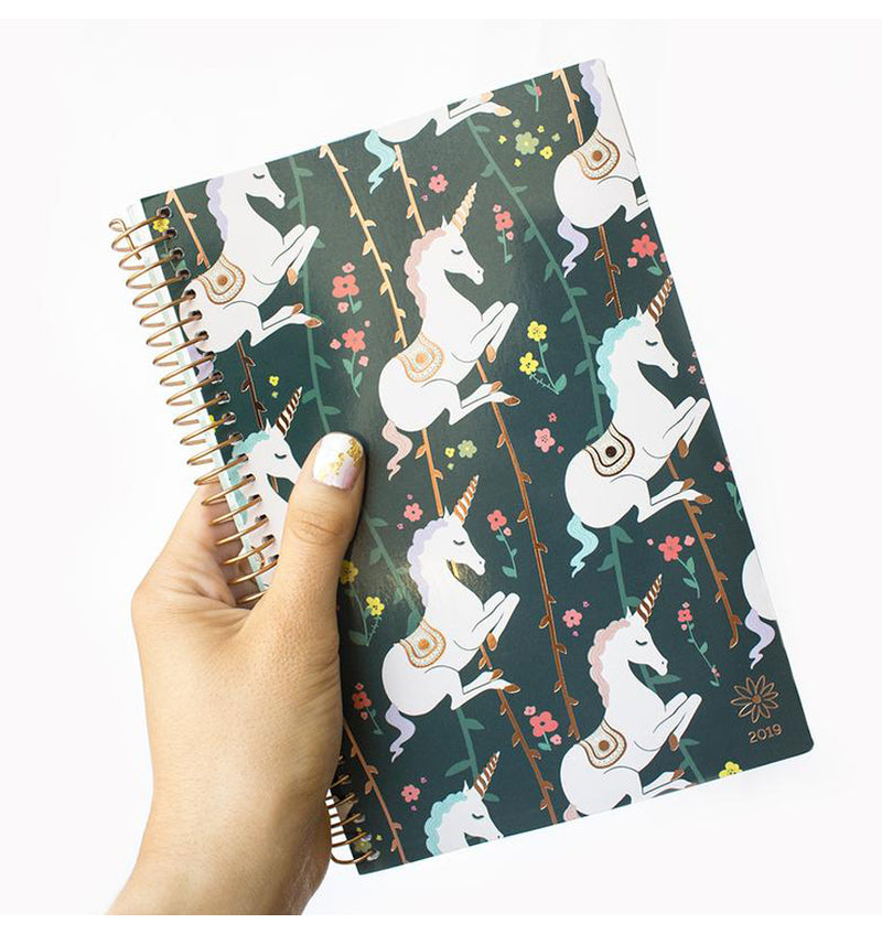 Holding a Bloom's Unicorn 2019 Soft Cover Daily Planner with Binder