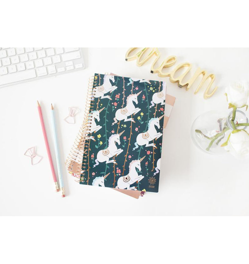 Bloom's Unicorn 2019 Soft Cover Daily Planner on a White Desk
