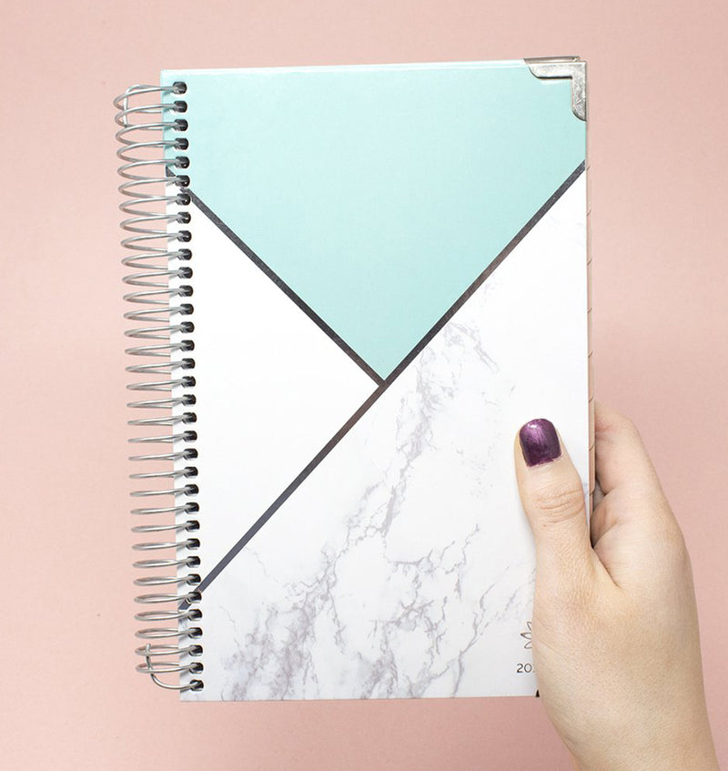 Holding a Blocking Marble Mint 2019-2020 Bloom Hard Cover Daily Planner
