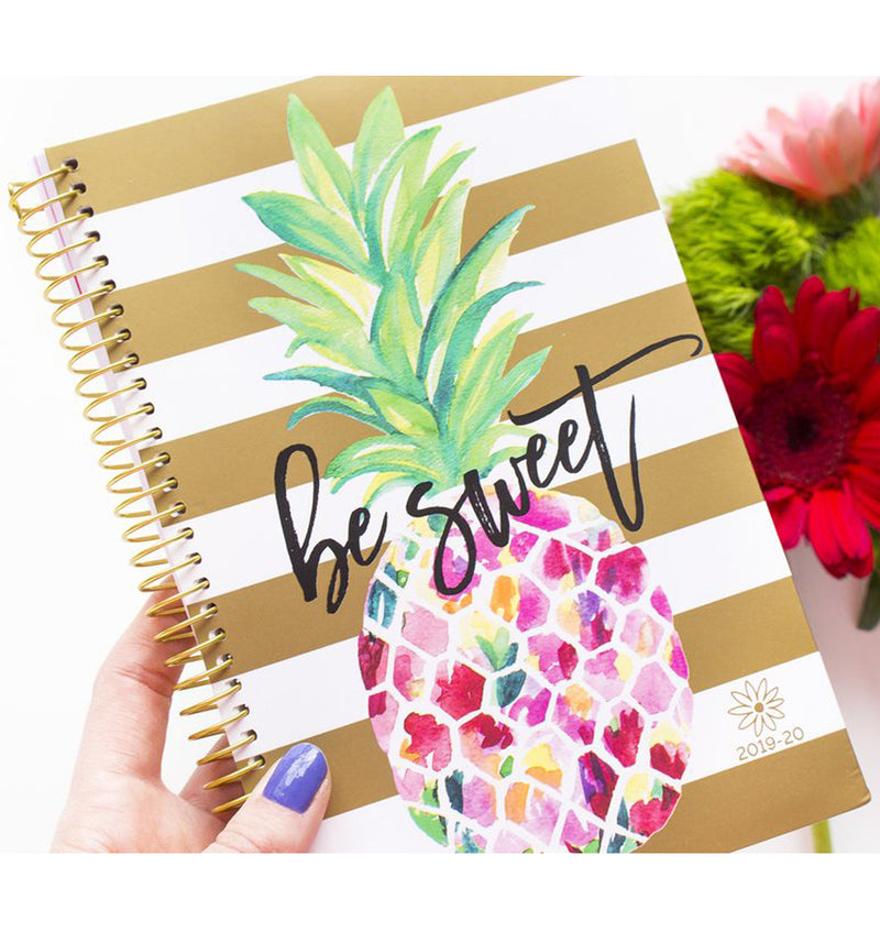 Holding a Be Sweet Pineapple 2019-2020 Bloom Soft Cover Daily Planner