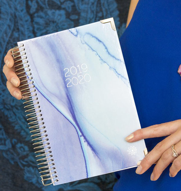 Holding a Blue Watercolor 2019-2020 Bloom Hard Cover Daily Planner