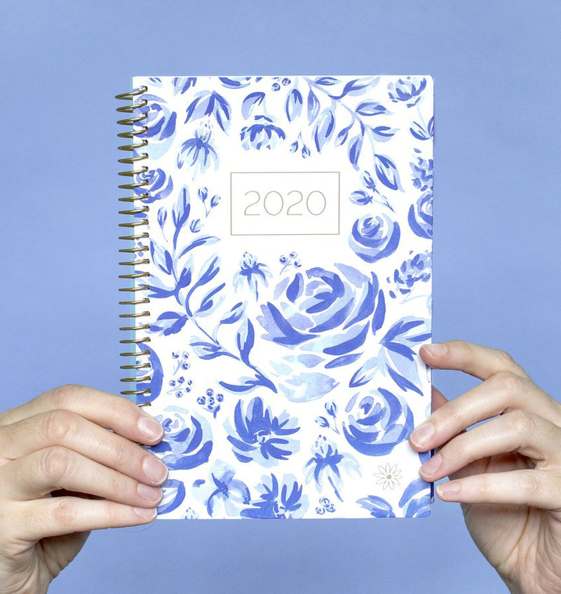Holding a Bloom Blue & White Floral 2020 Soft Cover Planner
