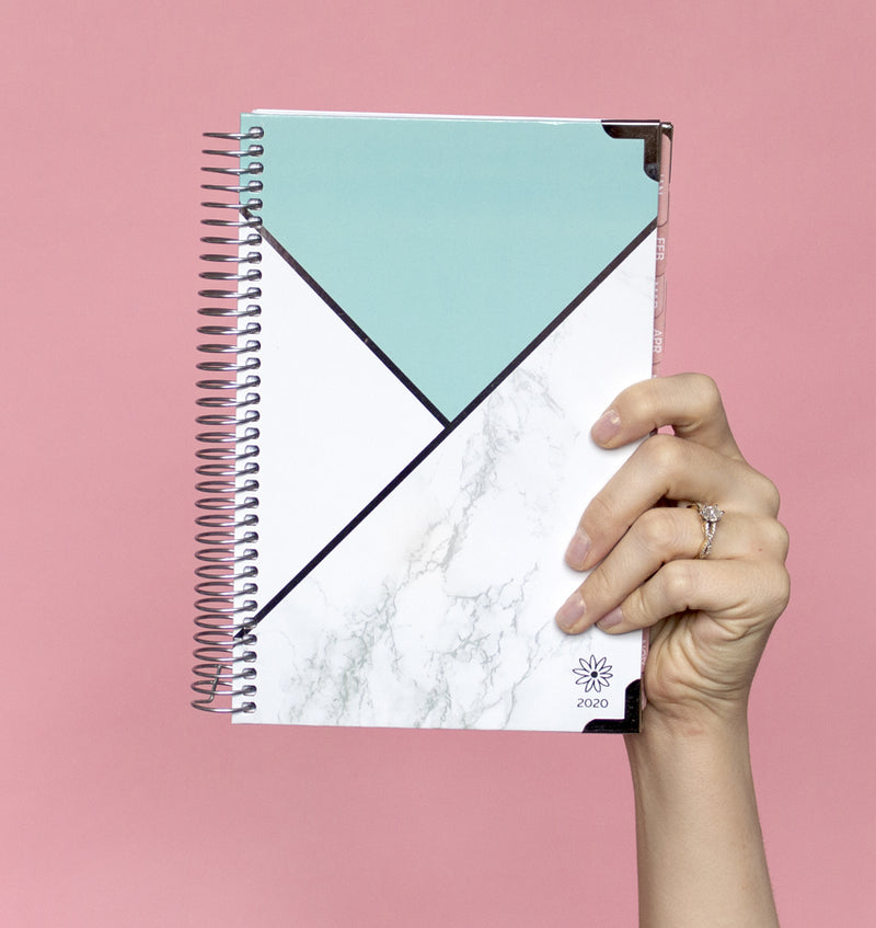 Holding a Bloom Mint Blocking Marble Hard Cover 2020 Daily Planner (12 Months)