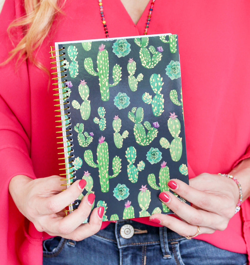 Holding a Navy Cacti 2019-2020 Bloom Soft Cover Daily Planner