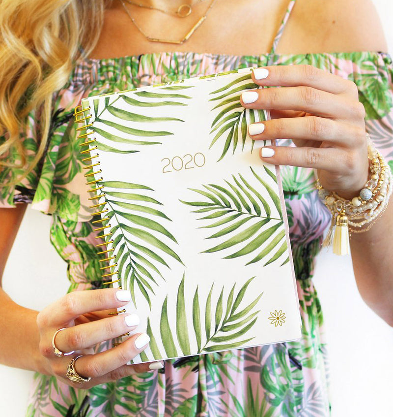 Holding a Bloom Palm Leaves 2020 Soft Cover Daily Planner