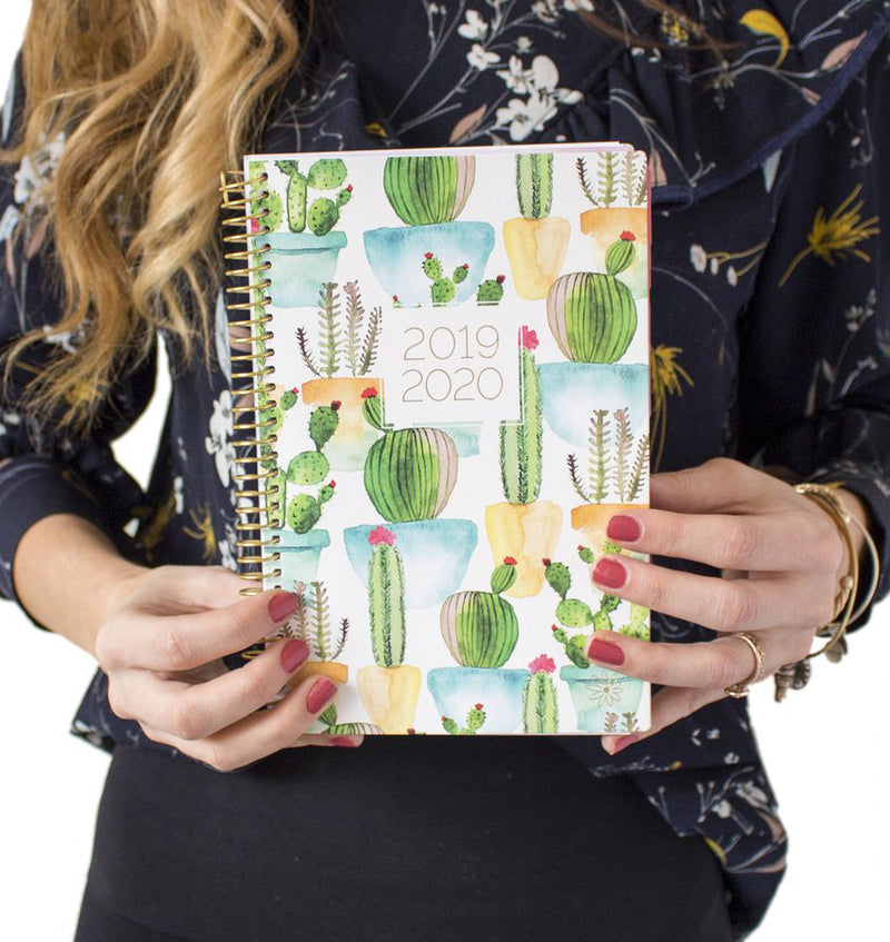 Holding a White Cacti 2019-2020 Bloom Soft Cover Daily Planner