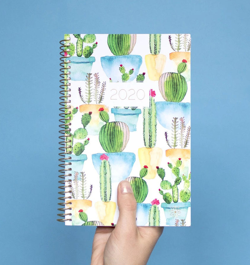 Holding a Bloom White Cacti 2020 Soft Cover Daily Planner