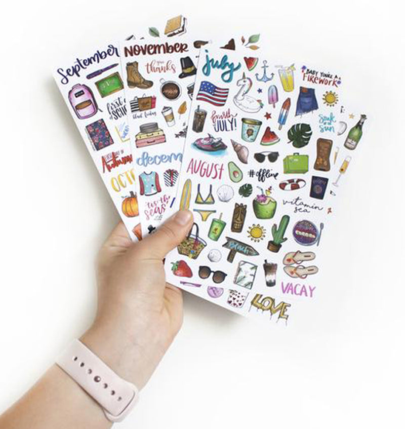 Holding a Bloom's Holiday Planner Sticker Sheets 6pcs Pack
