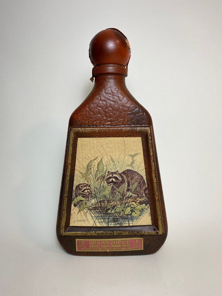 James B. Beam Distilling Co. Beam 8YO Kentucky Straight Bourbon Whiskey in Glass Decanter Painted with Raccoon after James Lockhart - Distilled 1970 / Bottled 1978 (40%, 75cl)