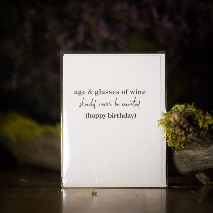 """Age and glasses of wine should never be counted (happy birthday)"" card"