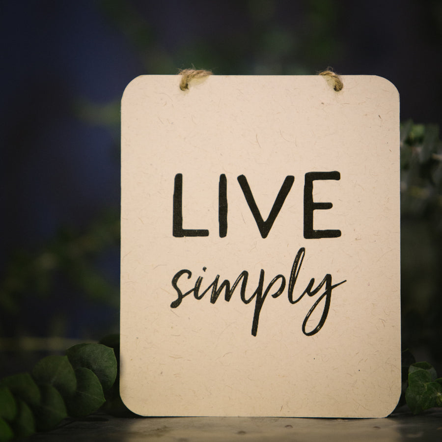 """Live Simply"" sign"