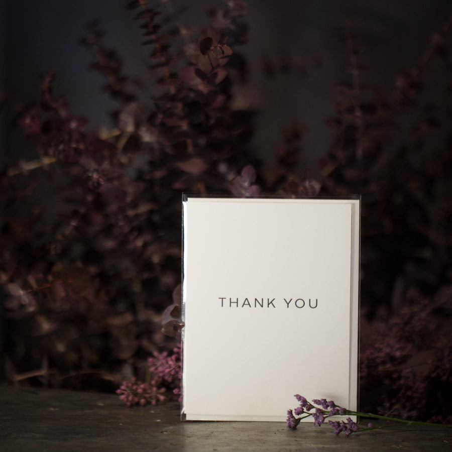 """Thank you"" black script card"