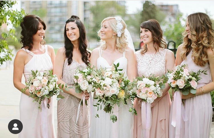 Bride and Bridesmaids Bouquets in pale blushes and ivory.