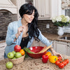 Nude Bee Recipe Authors - Rachel Sklar picking veggies in her kitchen