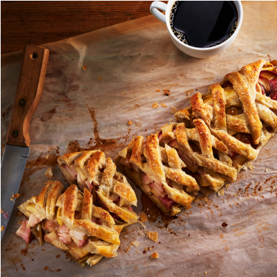 Apple Strudel With Honey On A Wood Cutting Board from Nude Bee Honey Company