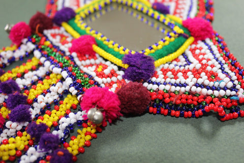 Tribal Patch with Large Mirror and Beaded Dangles close up