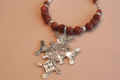 Sterling Silver Croix du Sud with Goldstone Beading close up of pendant