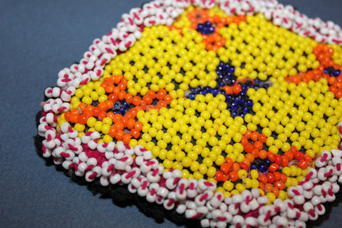 Diamond Shaped Beaded Medallion in Yellow close up