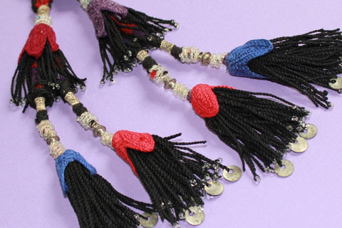 Vintage Beaded Double Tassel with Metal Amulet close up