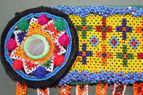 Colorful Heavily Beaded Belt Base medallion close up