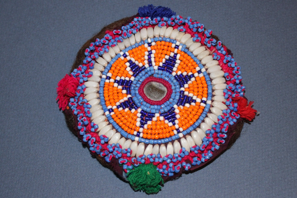 Orange Medallion with Pom Poms and Shells
