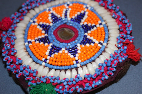 Orange Medallion with Pom Poms and Shells close up