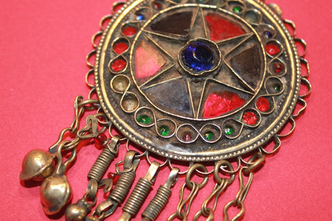 Round Pendant with Blue and Red Glass Star Motif close up
