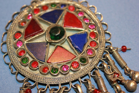 Round Pendant with Red and Blue Glass Star Motif close up