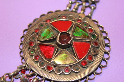 Round Kuchi Pendant with Red and Green Glass close up