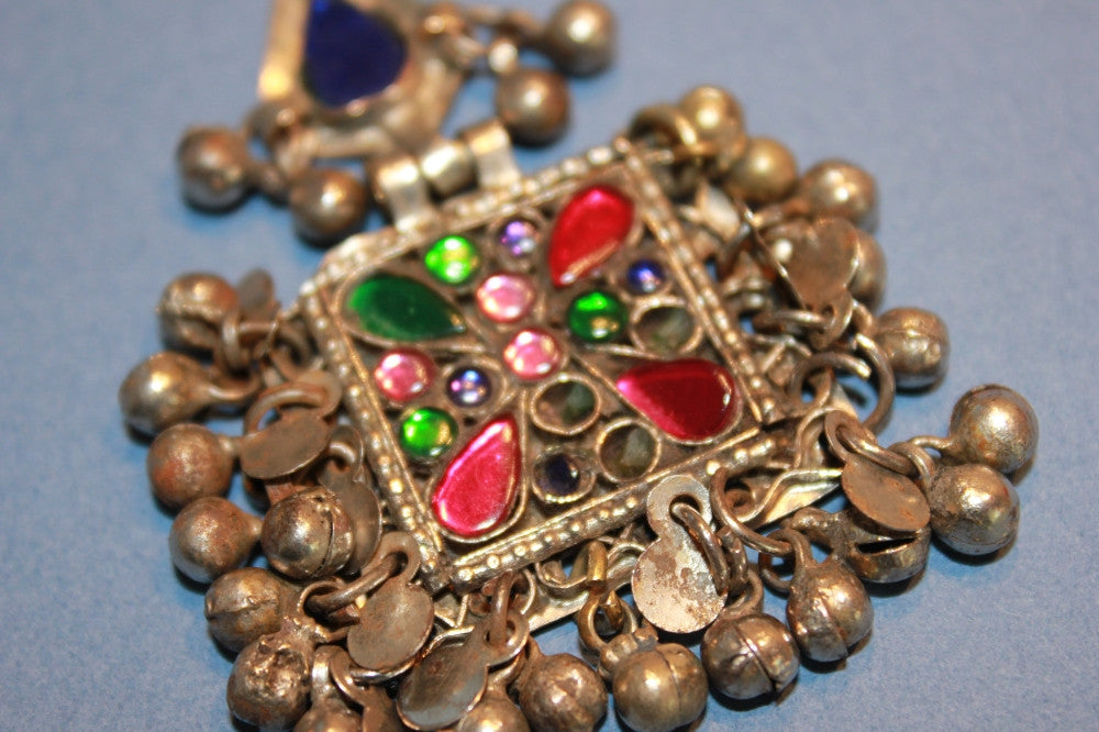 Square Tribal Pendant with Many Tiny Charms close up