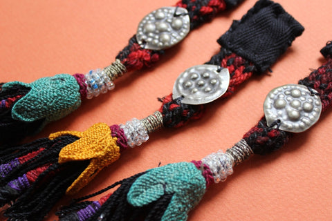 Vintage Beaded Tassel Trio with Metal Amulets close up 2