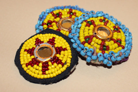 Yellow Beaded Rounds with Mirrored Centers close up