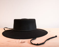 Wide Brim Gaucho Hat with Drawstring in Black Wool
