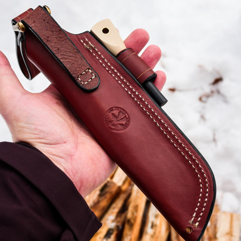 A chestnut brown leather sheath for a Classic bushcraft knife; matching firesteel, firesteel loop, removable dangler