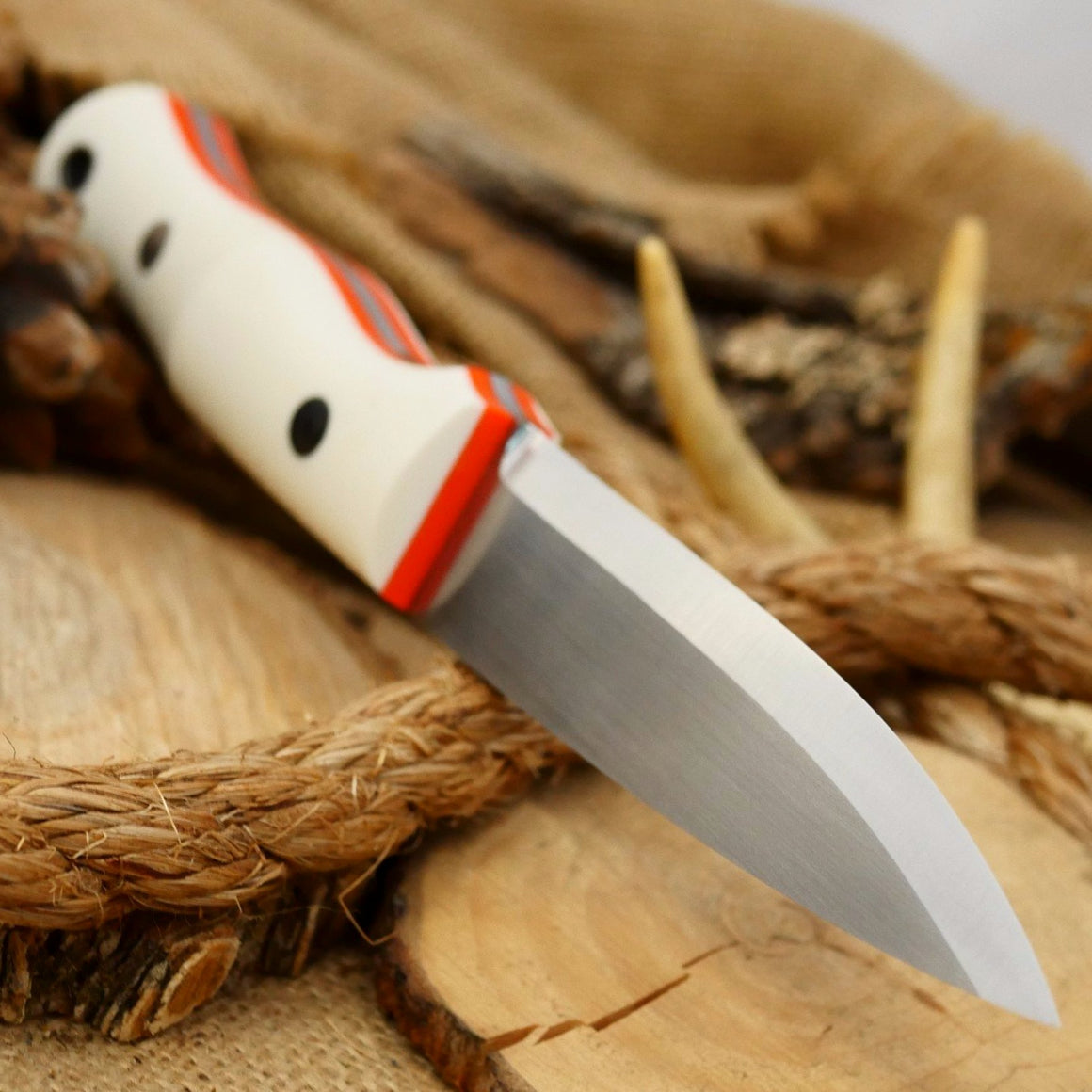 Mountaineer: White Linen & Orange G10